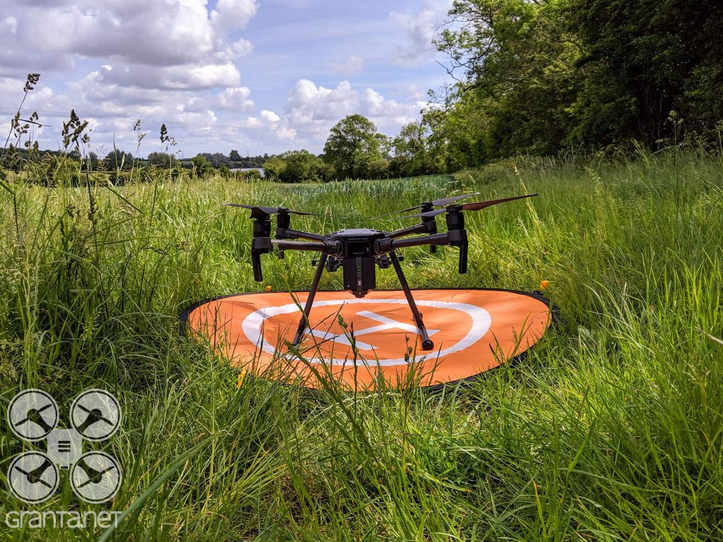 Our DJI Matrice 210 drone on a landing pad
